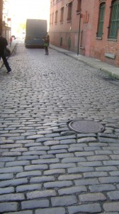 Below Whitman's old window, the street is still cobblestoned.